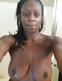 Busty black girlfriend takes selfshot pictures of her huge tits after getting out of the shower for her boyfriend